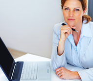Business woman working at laptop