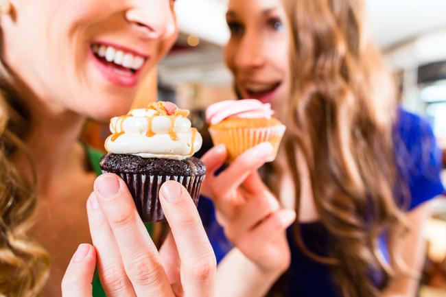 satisfied customers having cupcakes