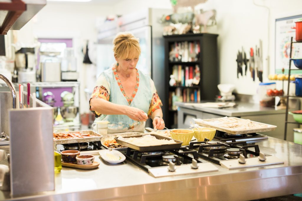 Sibby cooking at Onion Creek Kitchens