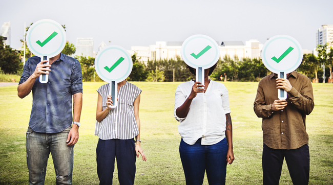 People Holding Check Marks