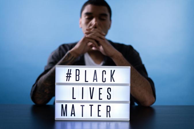 Black Lives Matter Sign and man
