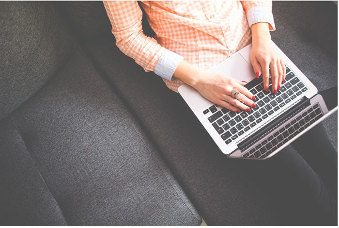 Blogger typing entries for digital marketing
