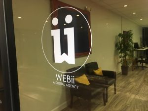 WEBii door signage in Austin